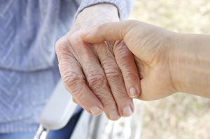 2013_05_31_elderly_people_holding_hands_large